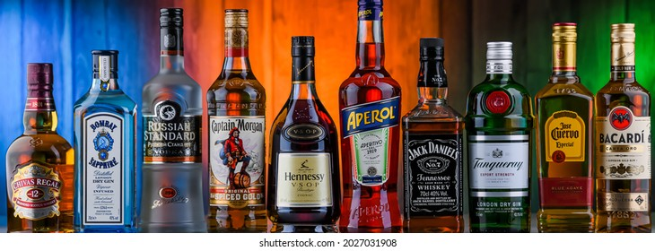 POZNAN, POL - AUG 05, 2021: Bottles of assorted global hard  liquor brands including whiskey, vodka, tequila and gin