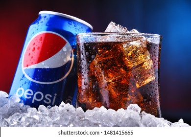 POZNAN, POL - AUG 13, 2019: A can and a glass of Pepsi, a carbonated soft drink produced and manufactured by PepsiCo. The beverage was created and developed in 1893 under the name Brad's Drink