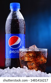 POZNAN, POL - AUG 13, 2019: A bottle and a glass of Pepsi, a carbonated soft drink produced and manufactured by PepsiCo. The beverage was created and developed in 1893 under the name Brad's Drink