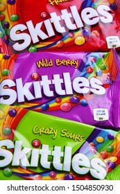 POZNAN, POL - AUG 21, 2019: Packages of Skittles, a brand of fruit-flavored candy, currently produced and marketed by the Wrigley Company