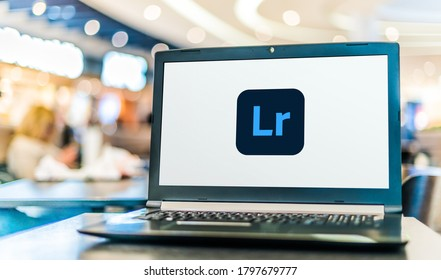 POZNAN, POL - AUG 8, 2020: Laptop computer displaying logo of Adobe Lightroom, a family of image organization and image manipulation software developed by Adobe Systems