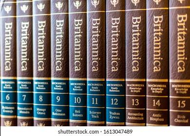 POZNAN, POL - DEC 11, 2019: Encyclopedia Britannica volumes on a shelf in a public library