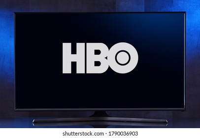 POZNAN, POL - FEB 04, 2020: Flat-screen TV set displaying logo of HBO, an American premium cable and satellite television network owned by Home Box Office, Inc.