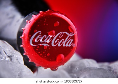 POZNAN, POL - FEB 25, 2021: Crown cap on a Coca-Cola bottle, a carbonated soft drink manufactured by The Coca-Cola Company headquartered in Atlanta, Georgia, USA