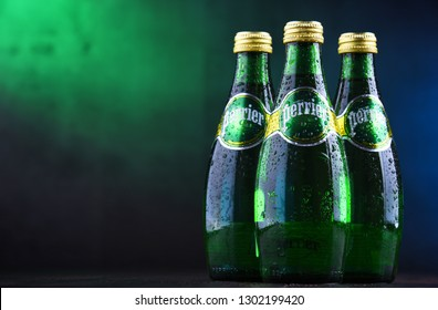 POZNAN, POL - JAN 24, 2019: Bottles of Perrier, a French brand of natural bottled mineral water sold worldwide and available in 140 countries.