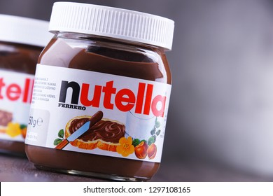 POZNAN, POL - JAN 25, 2019: Jars of Nutella, a widely popular brand name of a sweetened hazelnut cocoa spread, introduced to the market in 1964 by Italian company Ferrero.