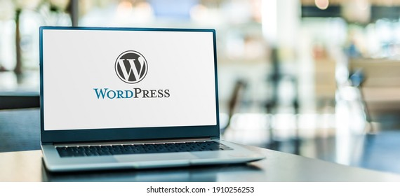POZNAN, POL - JAN 6, 2021: Laptop computer displaying logo of WordPress, a free and open-source content management system (CMS) written in PHP and paired with a MySQL or MariaDB database