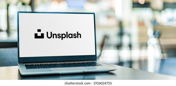 POZNAN, POL - JAN 6, 2021: Laptop computer displaying logo of Unsplash, a website dedicated to sharing stock photography under the Unsplash license.