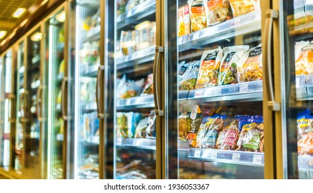 POZNAN, POL - MAR 09, 2021: Food products put up for sale in a commercial refrigerator