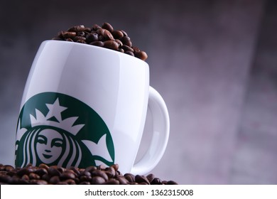 POZNAN, POL - MAR 29, 2019: Cup of Starbucks, the name of coffee company and coffeehouse chain, founded in Seattle, Wa. USA, in 1971; now the largest business of this kind in the world.