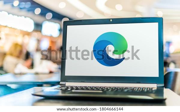 POZNAN, POL - MAY 15, 2020: Laptop computer displaying logo of Microsoft Edge, a web browser developed by Microsoft