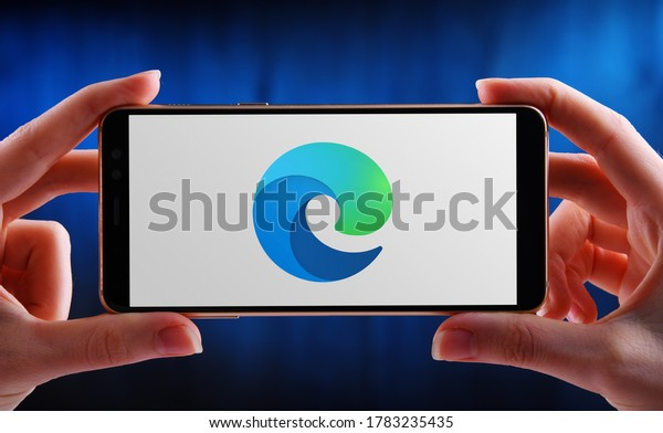 POZNAN, POL - MAY 21, 2020: Hands holding smartphone displaying logo of Microsoft Edge, a web browser developed by Microsoft