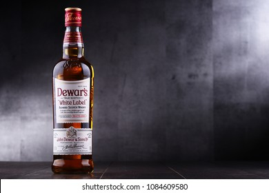 POZNAN, POL - MAY 3, 2018: Bottle of Dewars, a brand of whisky owned by Bacardi, the world's most awarded blended Scotch