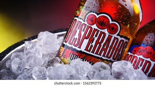 POZNAN, POL - NOV 8, 2019: Bottles of Desperados pale lager flavored with tequila, a popular beer produced by Heineken and sold in over 50 countries.
