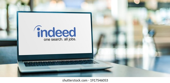 POZNAN, POL - SEP 23, 2020: Laptop computer displaying logo of Indeed, an American worldwide employment-related search engine for job listings