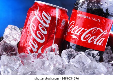POZNAN, POL - SEP 5, 2019: Bottle and can of Coca-Cola, a carbonated soft drink manufactured by The Coca-Cola Company headquartered in Atlanta, Georgia, USA