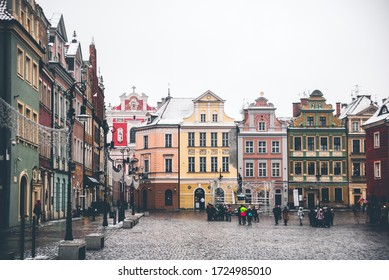 POZNAN, POLAND - 04 January 2019: Colorful facades of the buildings on the central market square in the snowless winter, Poznan, Poland