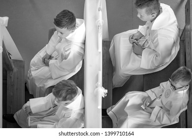 Poznan / Poland - 05.10.2019: boys in a church awaiting the first communion. Black and white photo.