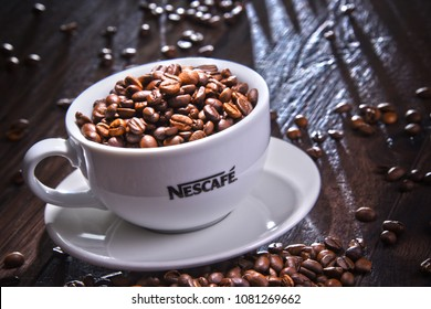POZNAN, POLAND - APR 12, 2018: Cup of Nescafe coffee, a brand of Swiss coffee made by Nestle and introduced in 1938