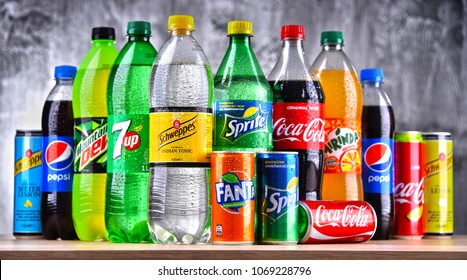 POZNAN, POLAND - APR 6, 2018: Bottles of global soft drink brands including products of Coca Cola Company and Pepsico