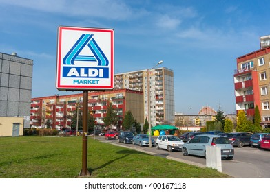 POZNAN, POLAND - APRIL 03, 2016: Aldi Market supermarket sign on green grass by apartment buildings at the Stare Zegrze area