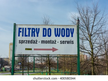 POZNAN, POLAND - APRIL 04, 2016: Sign showing the way to a water filter store on the Polan area