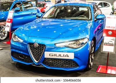Poznan, Poland, April 05, 2018: metallic blue Alfa Romeo Giulia at Poznan International Motor Show, compact executive car produced by Italian car manufacturer Alfa Romeo