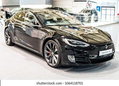 Poznan, Poland, April 05, 2018: metallic black Tesla Model S P100D at Poznan International Motor Show, produced by American automaker Tesla, main shareholder Elon Musk