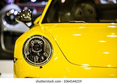 Poznan, Poland, April 05, 2018: metallic yellow Porsche 911 Carrera T at Poznan International Motor Show, sports cars built by Porsche