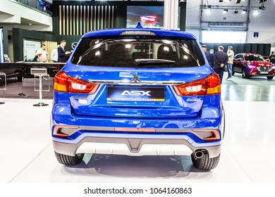Poznan, Poland, April 05, 2018: metallic blue Mitsubishi ASX at Poznan International Motor Show, compact crossover SUV produced by Japanese automaker Mitsubishi Motors