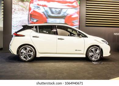 Poznan, Poland, April 05, 2018: metallic white Nissan Leaf at Poznan International Motor Show, compact five-door hatchback electric car manufactured by Nissan