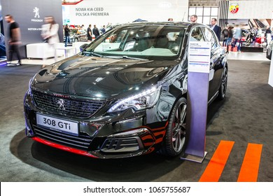 Poznan, Poland, April 05, 2018: metallic black new Peugeot 308 GTi at Poznan International Motor Show- car produced by Peugeot - French car manufacturer, part of Groupe PSA