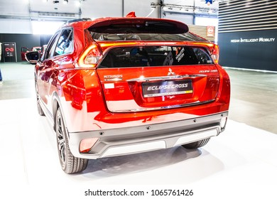 Poznan, Poland, April 05, 2018: metallic red Mitsubishi Eclipse Cross at Poznan International Motor Show, compact crossover SUV produced by Japanese automaker Mitsubishi Motors