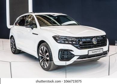 Poznan, Poland, April 05, 2018: metallic white new Volkswagen VW Touareg R-Line 2018 model at Poznan International Motor Show, produced by German automaker Volkswagen Group