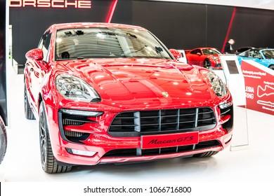 Poznan, Poland, April 05, 2018: metallic red Porsche Macan GTS at Poznan International Motor Show, five-door luxury crossover SUV (CUV) produced by German car manufacturer Porsche