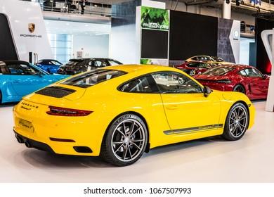 Poznan, Poland, April 05, 2018: metallic yellow Porsche 911 Carrera T at Poznan International Motor Show, two-seater sports cars built by Porsche