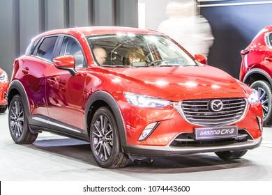 Poznan, Poland, April 05, 2018: metallic red Mazda CX-3 AWD Skyactiv Technology at Poznan International Motor Show, car manufactured in Japan by Mazda