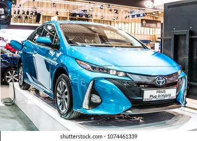Poznan, Poland, April 05, 2018: metallic blue Toyota Prius Plug-in Hybrid at Poznan International Motor Show, produced by Japanese automaker, Toyota booth