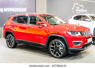Poznan, Poland, April 05, 2018: metallic red Jeep Compass 4x4 compact crossover SUV at Poznan International Motor Show, Jeep is a brand of American automobiles