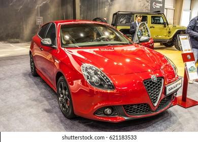POZNAN, POLAND, APRIL 06-09, 2017: MOTOR SHOW, INTERNATIONAL CAR FAIR: Alfa Romeo Giulietta - shiny modern auto