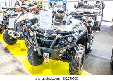 Poznan, Poland, April 06-09, 2017: MOTOR SHOW, International Car Fair: BRP Can-am Outlander 1000R XT-P ATV shiny modern 4x4 quad