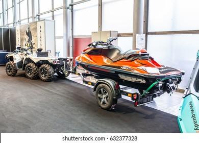Poznan, Poland, April 06-09, 2017: MOTOR SHOW, International Car Fair: BRP Can-am Outlander 6x6 with Sea-doo RXP 300 shiny modern quad and jetski