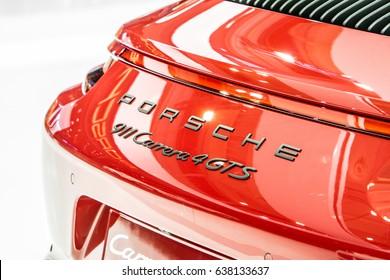 Poznan, Poland, April 06-09, 2017: MOTOR SHOW, International Car Fair: shiny modern sport auto Porsche 911 Carrera 4GTS