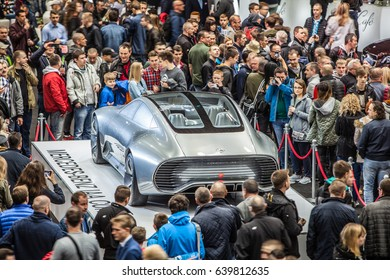 Poznan, Poland, April 06-09, 2017: MOTOR SHOW, International Car Fair: silver glossy and shiny modern Mercedes Concept IAA vehicle produced by the Mercedes-Benz company, Surrounded by crowds of people