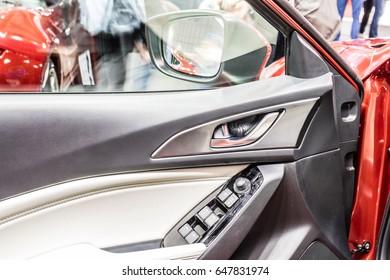 Poznan, Poland, April 06-09, 2017: MOTOR SHOW, International Car Fair: inside of Mazda 3, door view - shiny modern auto