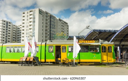 POZNAN, POLAND - APRIL 10, 2017: Inactive tram containing Caffe Bimba cafe and Zapiekanka XXL snack bar on the Rataje station on a sunny day