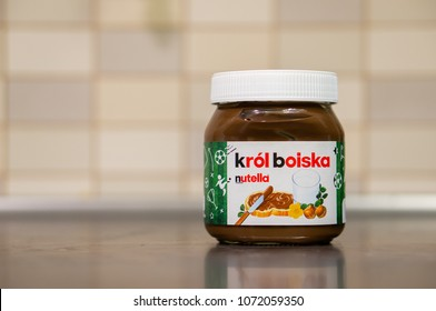 Poznan, Poland - April 14, 2018: Ferrero Nutella hazelnut chocolate spread in a glass jar on wooden table. Football edition related to Russia 2018 World Cup.