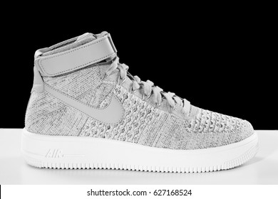 POZNAN, POLAND- April 23, 2017: NIKE Air Force 1 Ultra Flyknit Mid men's shoes on the white and black background.