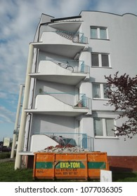 Poznan, Poland - April 25, 2018: Eko-Tom container in front of a 4 floors apartment building