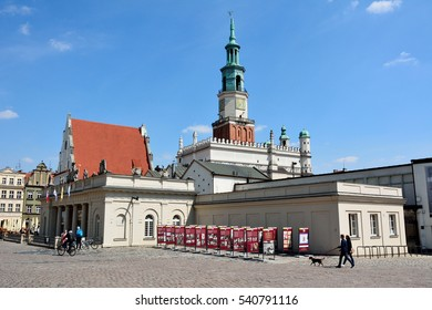 POZNAN, POLAND - APRIL 30, 2016. Town Hall historic building at Stary Rynek square in Poznan, with surrounding historic buildings and people.